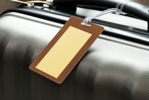 Etiqueta de identificação da mala. Foto: Shutterstock